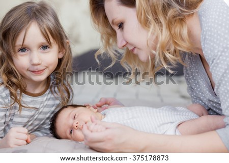 Young mother with her newborn and preschool children - stock photo
