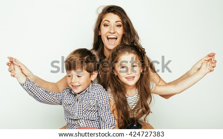 young mother with two children on white, happy smiling family inside isolated close up - stock photo