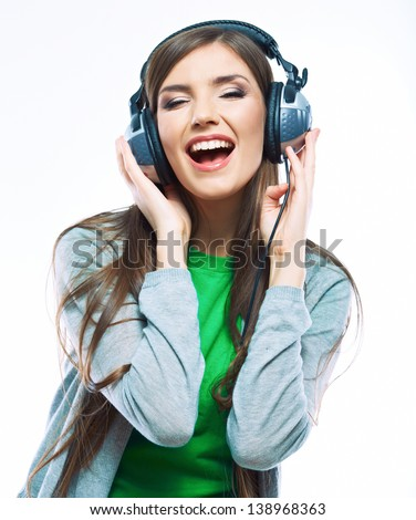 Young motion woman with headphones listening music .Music teenager girl dancing against isolated white background. Beautiful female model. - stock photo