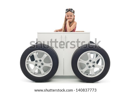 Young motorist concept - little girl with her vehicle, isolated - stock photo