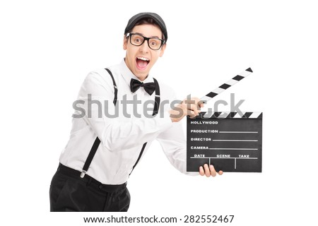 Young movie director holding a clapperboard and looking at the camera isolated on white background - stock photo