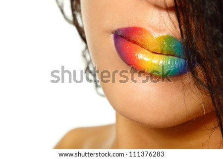 Young mulatto fresh woman with rainbow vivid color lips. Isolated on white background - stock photo