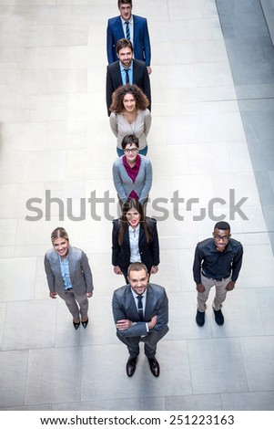 young multi ethnicbusiness people group walking standing and top view - stock photo