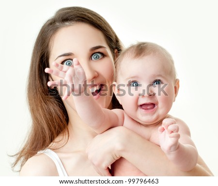 Young mummy and her kid - stock photo