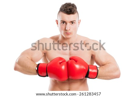 Young, muscular and shirtless boxer wearing red gloves on white background - stock photo