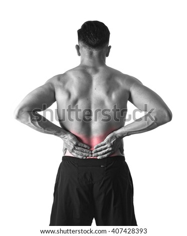 young muscular body sport man holding sore low back waist with hands  suffering pain in athlete stress and health care concept isolated background black and white red spot injury - stock photo