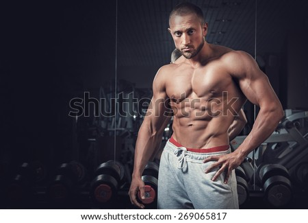 Young muscular guy with sexy body - stock photo