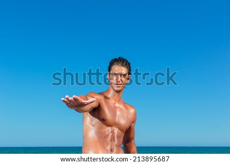 YOung muscular man on the beach - stock photo