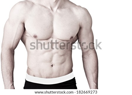 Young muscular man's torso with six pack - isolated on white - stock photo