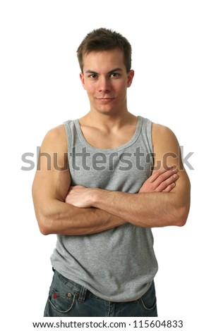 Young muscular man wearing a gray sleeveless shirt isolated on white - stock photo