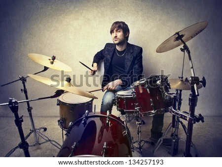 young musician playing drums - stock photo