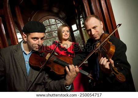 Young musician playing violin - stock photo