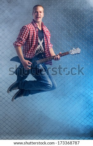 Young musician with electric guitar - stock photo