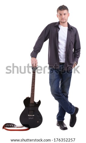 Young musician with guitar isolated on white - stock photo