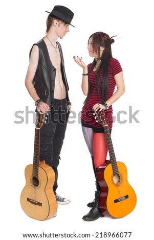 Young musicians with guitars. Interracial young couple, Asian woman and Caucasian man.  - stock photo