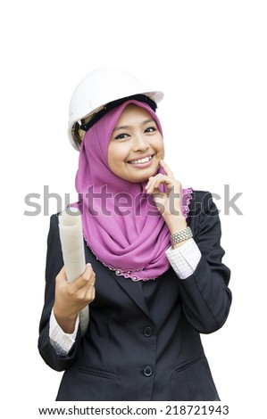 Young Muslim architect-woman wearing a protective helmet - stock photo