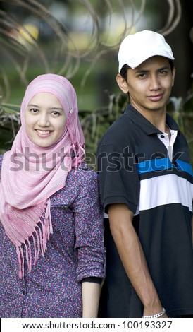 Young Muslim couple in happy smile action. - stock photo