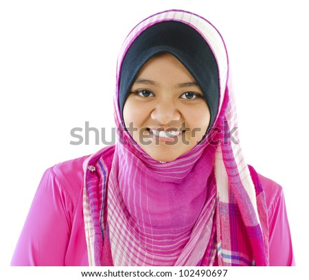 Young Muslim girl smiling on white background - stock photo
