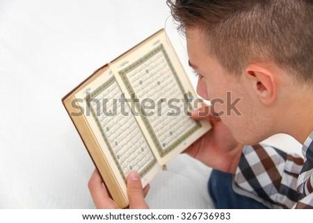 Young Muslim Man Is Praying, Islam Religion - stock photo