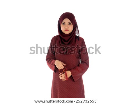 Young muslim woman holding a rosery tasbih with isolated white background  - stock photo