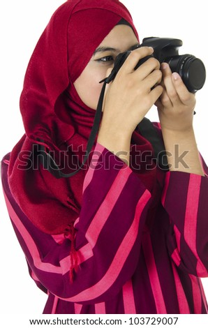 Young Muslim woman photographer. - stock photo