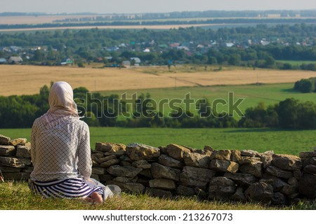 Young muslim woman praying outdoor - stock photo