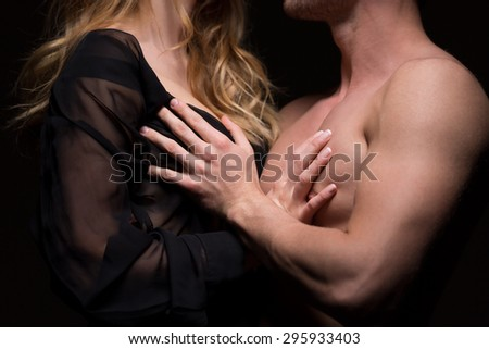 Young naked couple touching each other passionately - stock photo