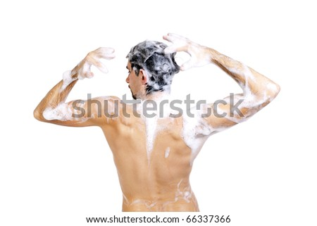 Young naked man taking a shower in foam with beautiful body isolated on white background - stock photo