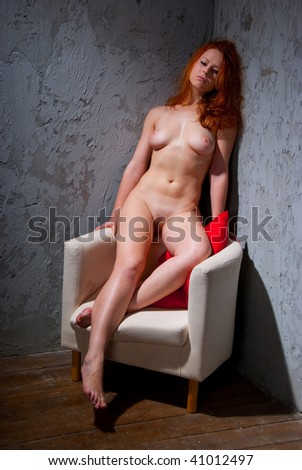 Young naked woman girl lies on a chair - stock photo