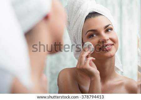 Young natural woman removing make-up after shower - stock photo