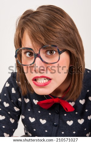 Young nerdy creepy girl. Studio shot. - stock photo