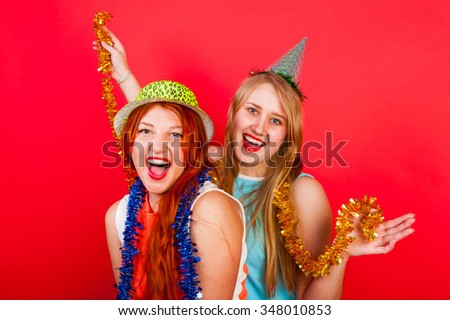 Young nice girls have fun on a party - stock photo