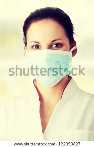 Young nurse or doctor in mask - stock photo