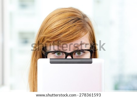 Young office-girl surfing on the internet. - stock photo