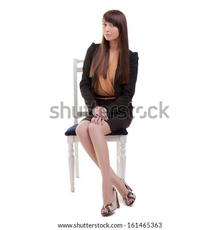 Young office worker sits in an vintage chair. Isolated on White. - stock photo
