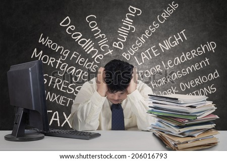 Young overweight businessman stressful in the office - stock photo