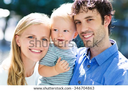 Young parents with baby boy  - stock photo