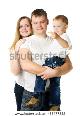 Young parents with son on hands in white T-shirts stand isolated on white,  kid points a finger in the camera - stock photo