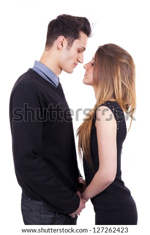 Young passionate couple hugging, kissing and looking each other - stock photo