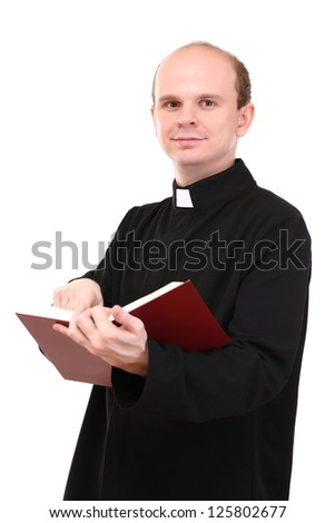 Young pastor with Bible, isolated on white - stock photo