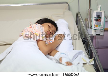 Young patient in hospital bed - stock photo