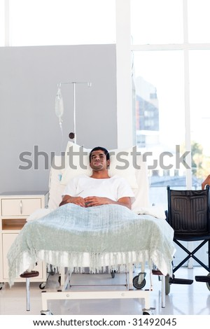 Young patient recovering in bed in hospital with copy-space - stock photo