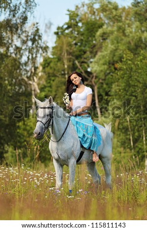 Young peasant woman rides a horse - stock photo