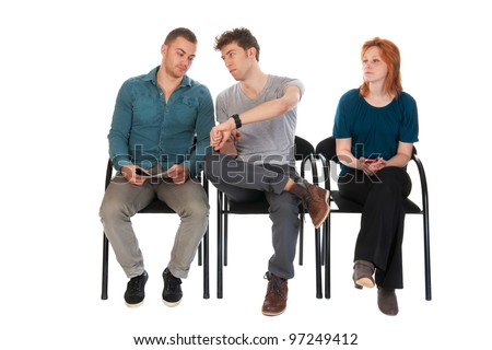 Young people are long waiting in a room - stock photo