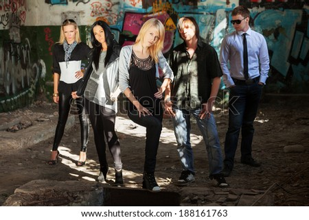 Young people at abandoned apartment - stock photo