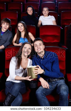 Young people at the cinema - stock photo