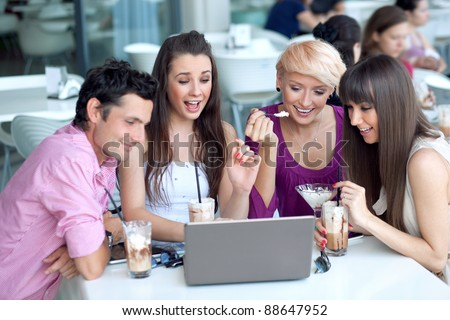 Young people browsing internet in a restaurant - stock photo