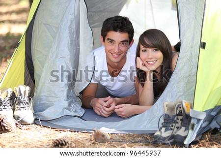 Young people camping - stock photo