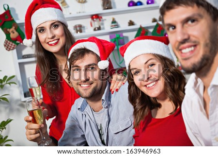 Young people celebrating new year. - stock photo