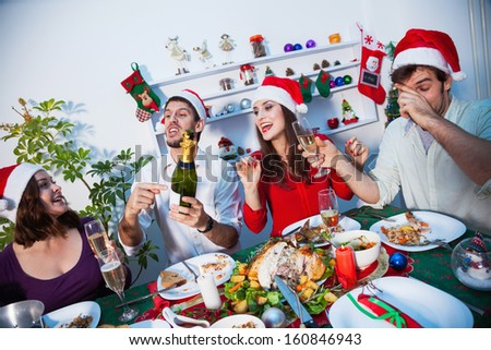 Young people celebrating together new year's eve - stock photo